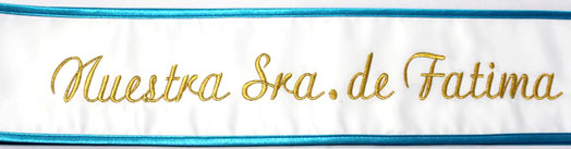 white and blue pageant sash with gold letters